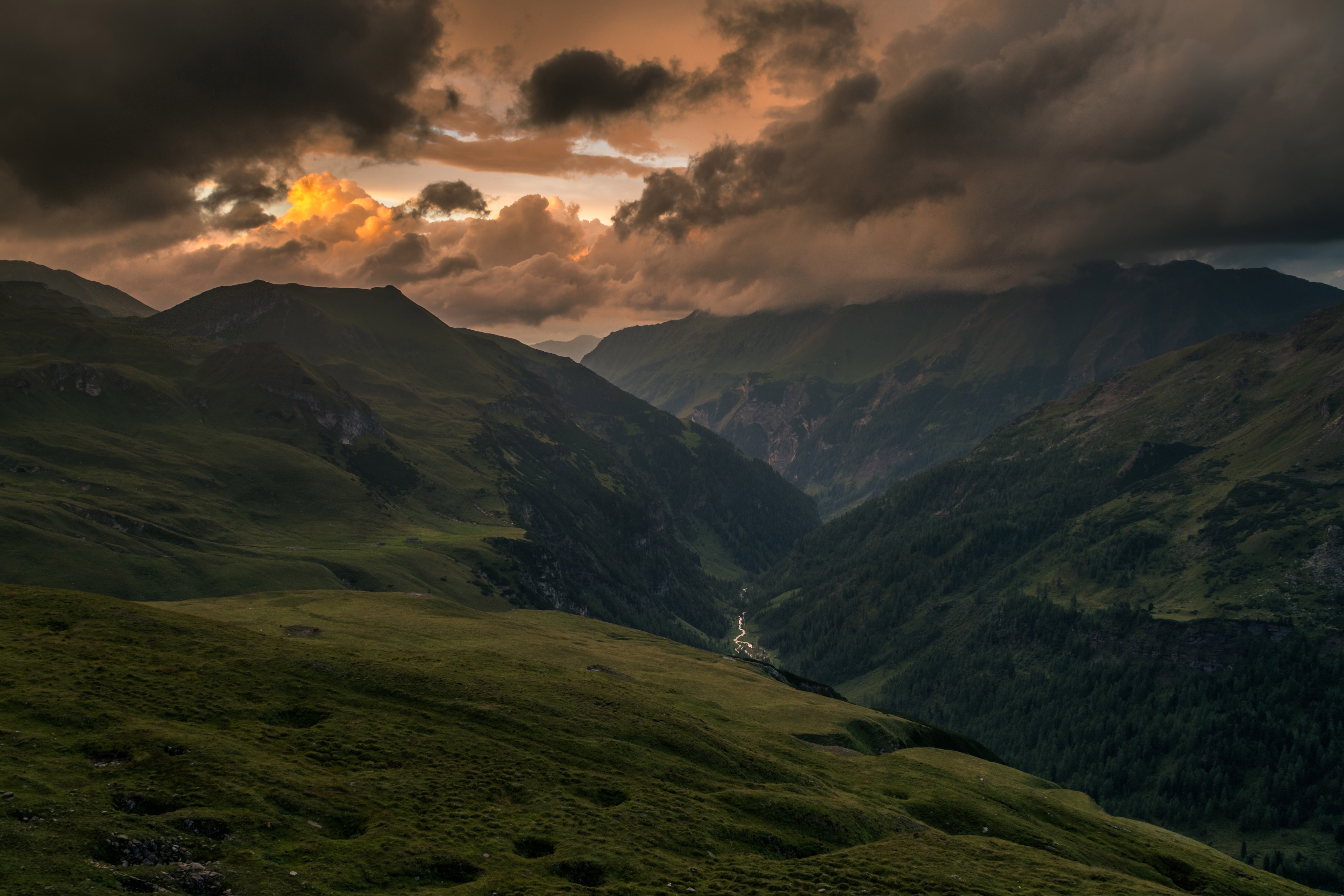 red clouds after sunset in the hills landscape in austria image - free stock photo