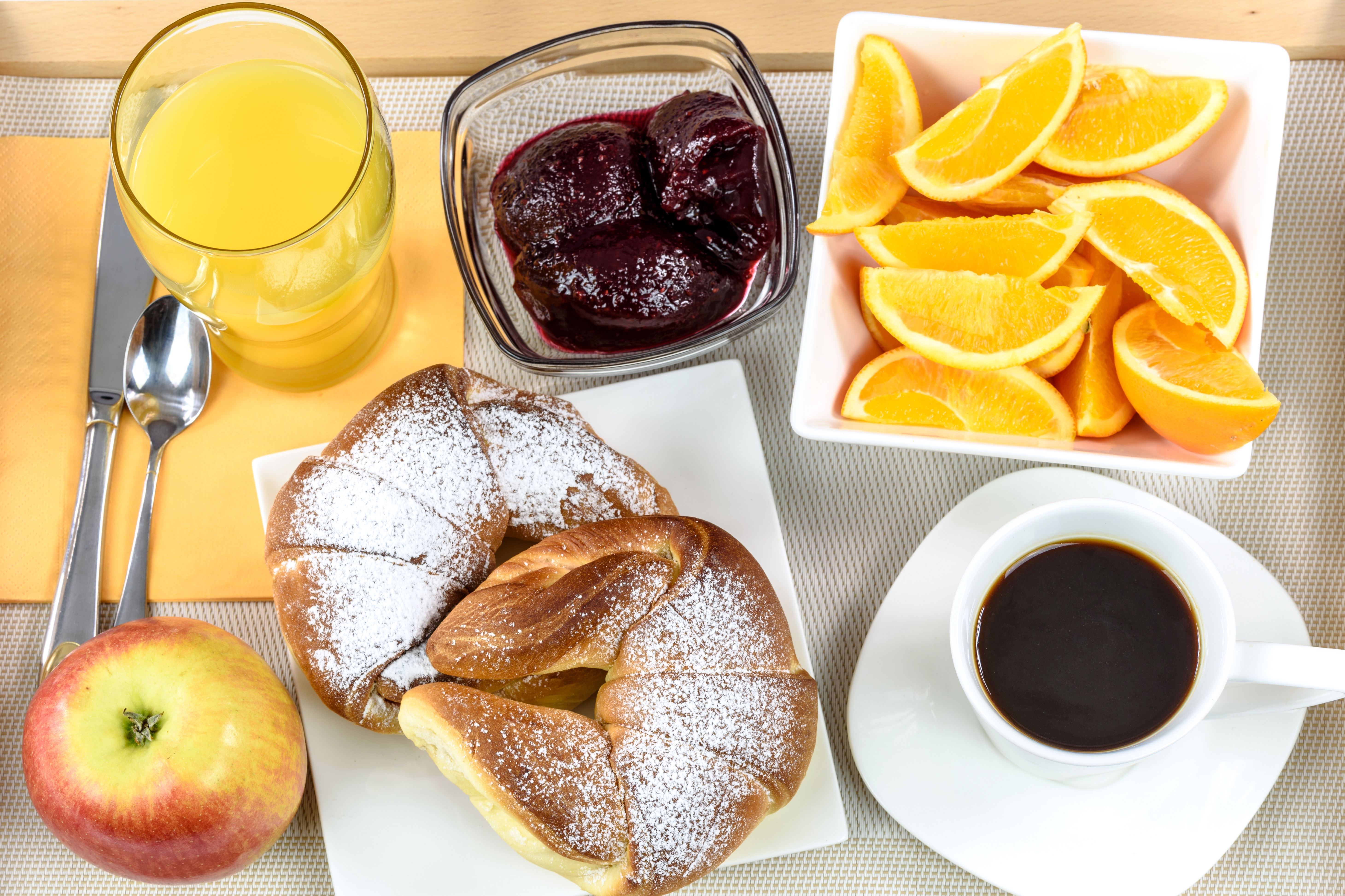 Hotel breakfast tray with oranges coffee and juice and for Hotel espresso