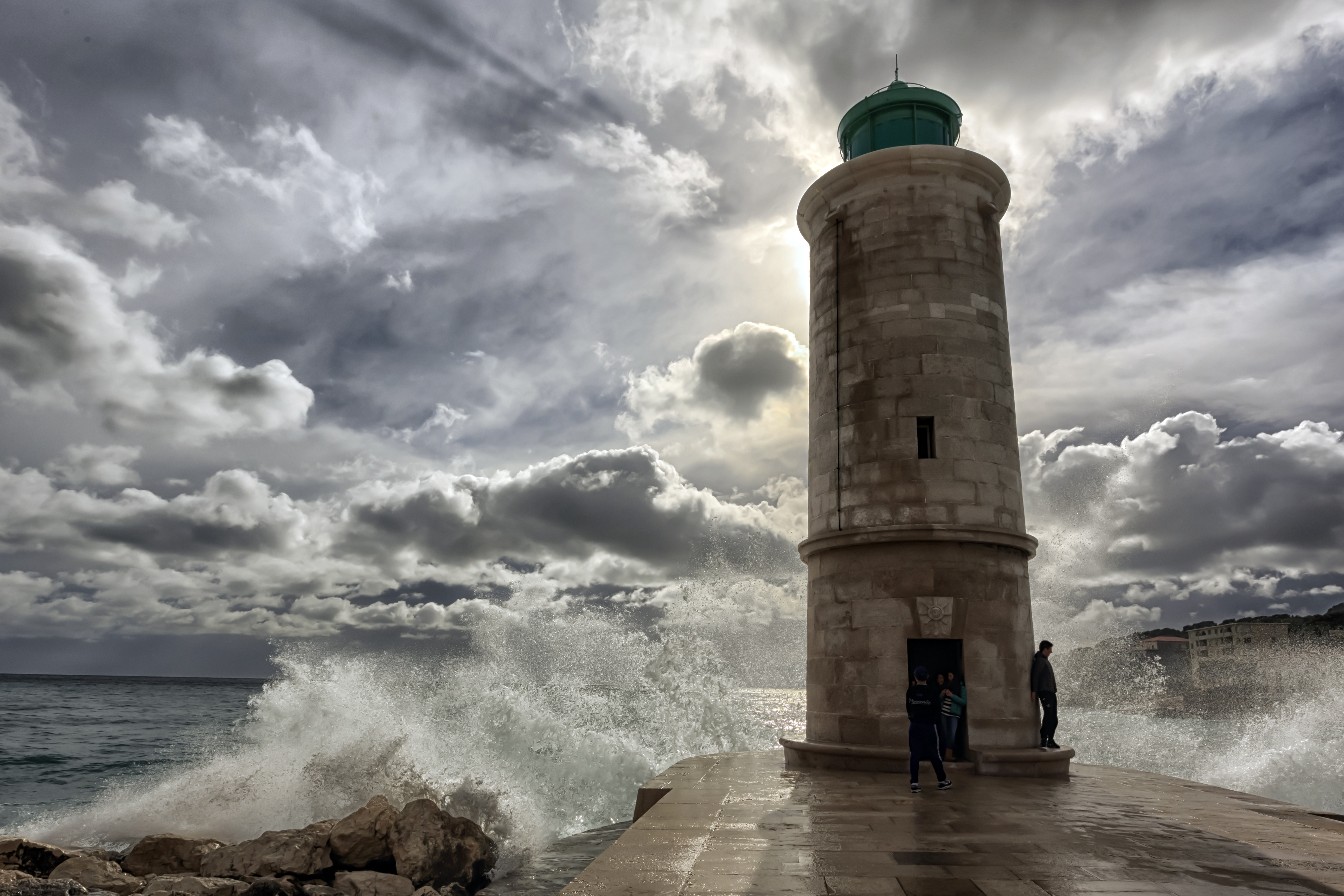 ... Wenphotos . Majestic Lighthouse under the Clouds at Marseille, France