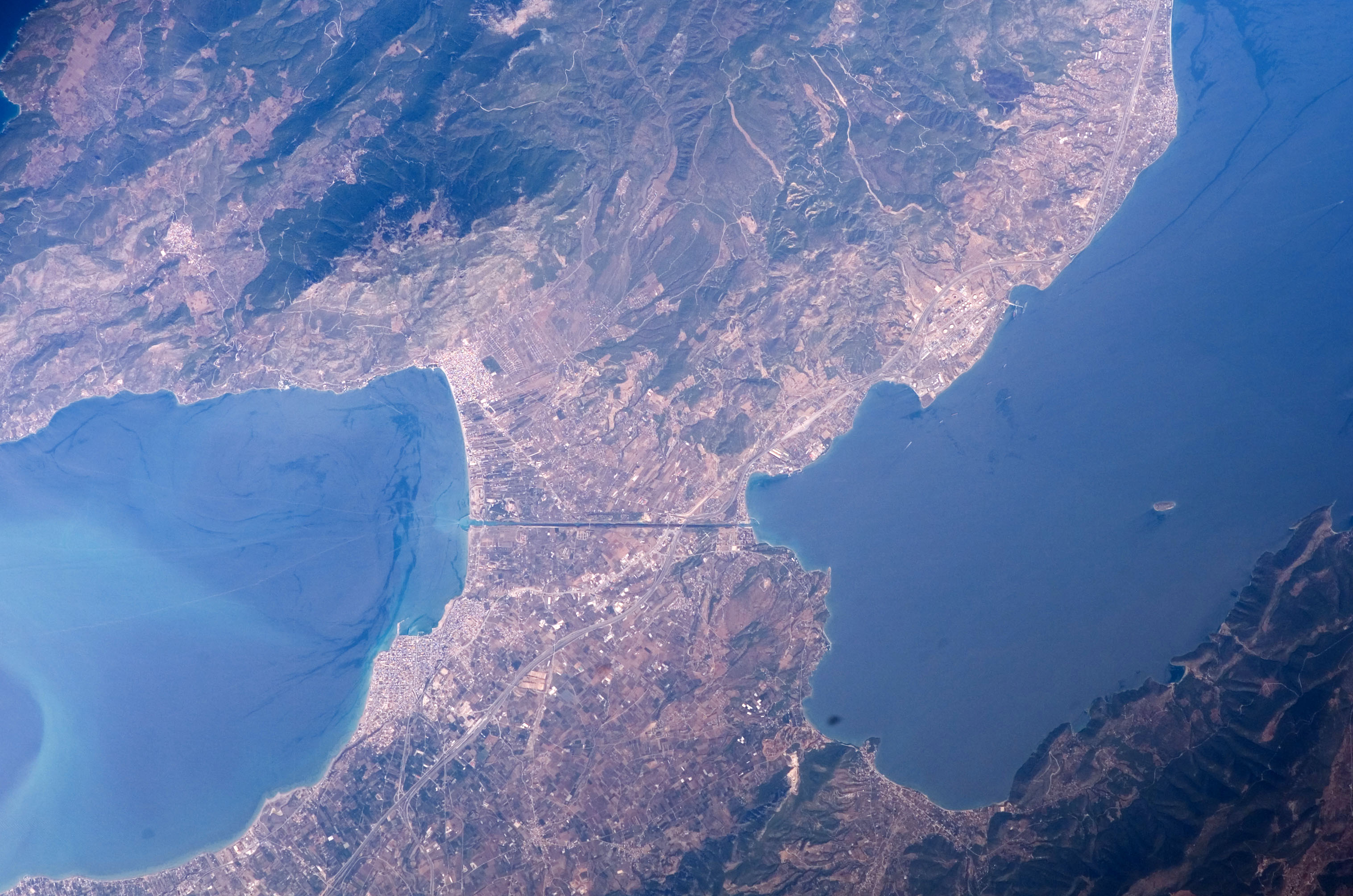 isthmus of corinth from space in greece image free stock photo