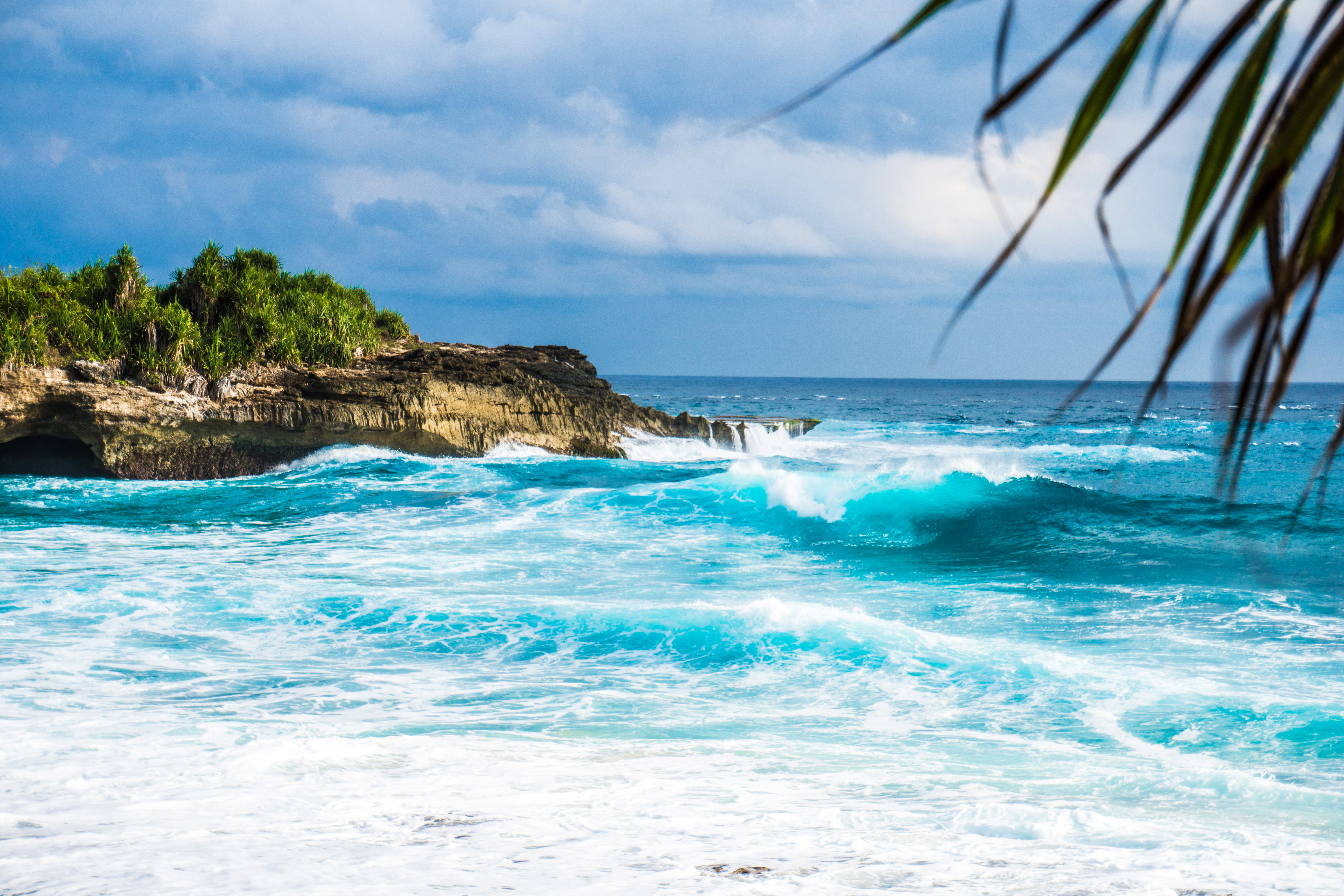 free stock photo of waves on the ocean crashing on shore in indonesia