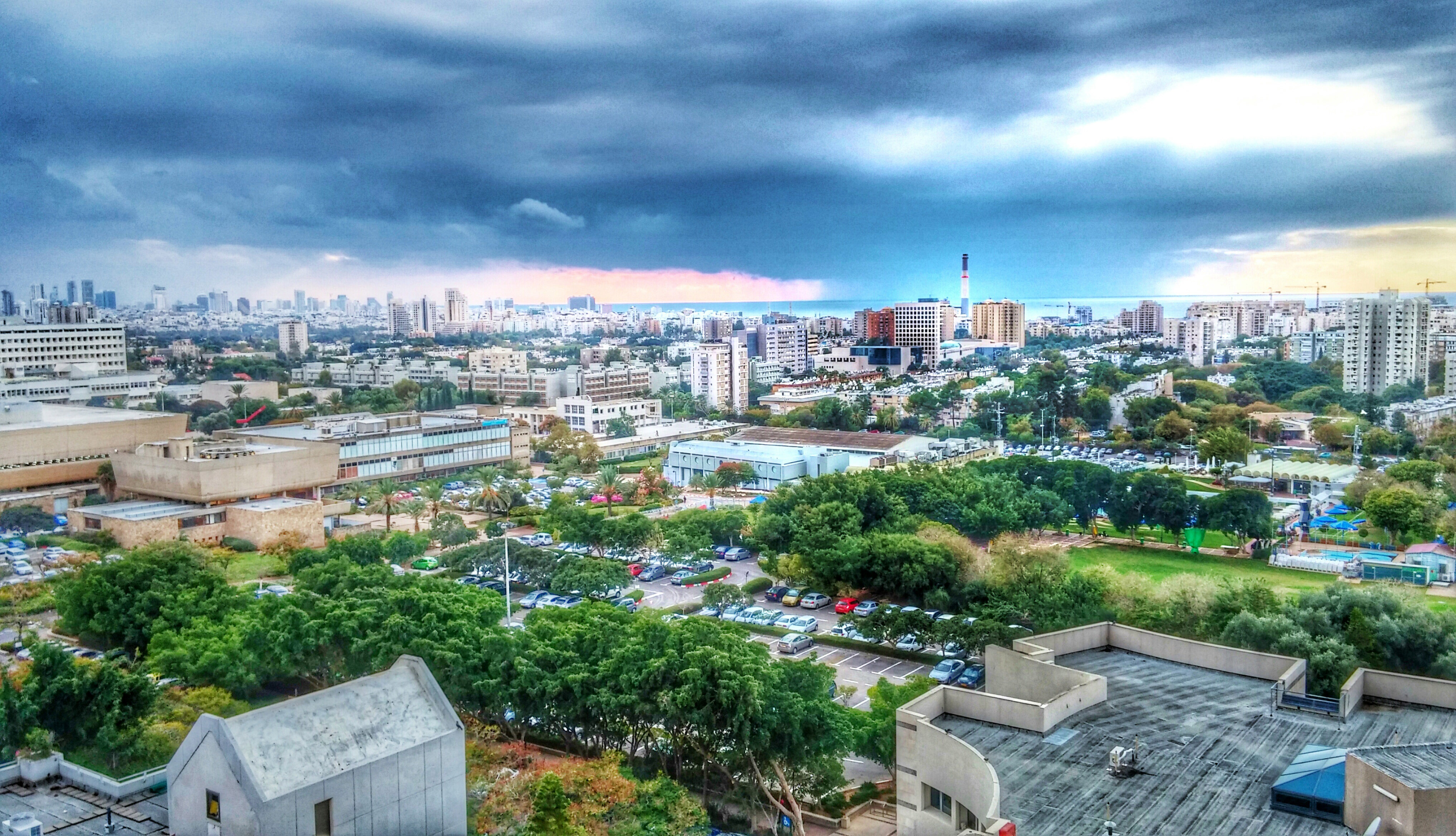 free stock photo of skyline of the cityscape with storm brewing in