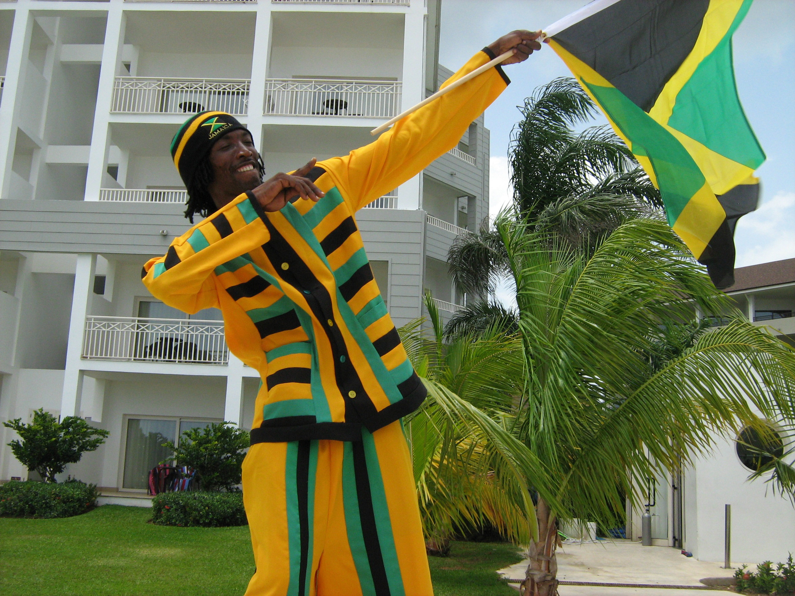 Man holding Jamaican Celebration Flag image - Free stock photo ...