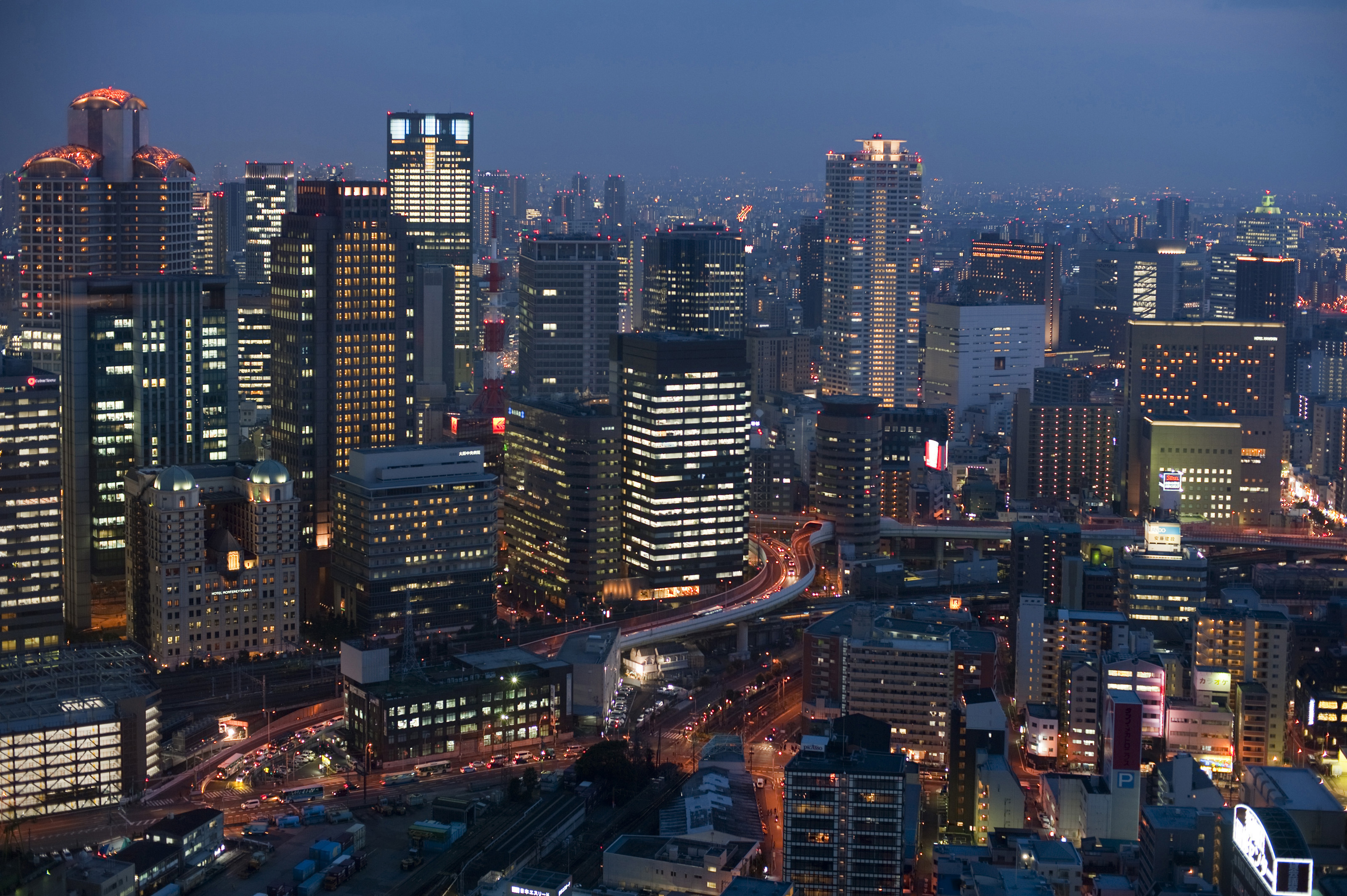 Osaka Cityscape At Night With Skyscrapers Image Free