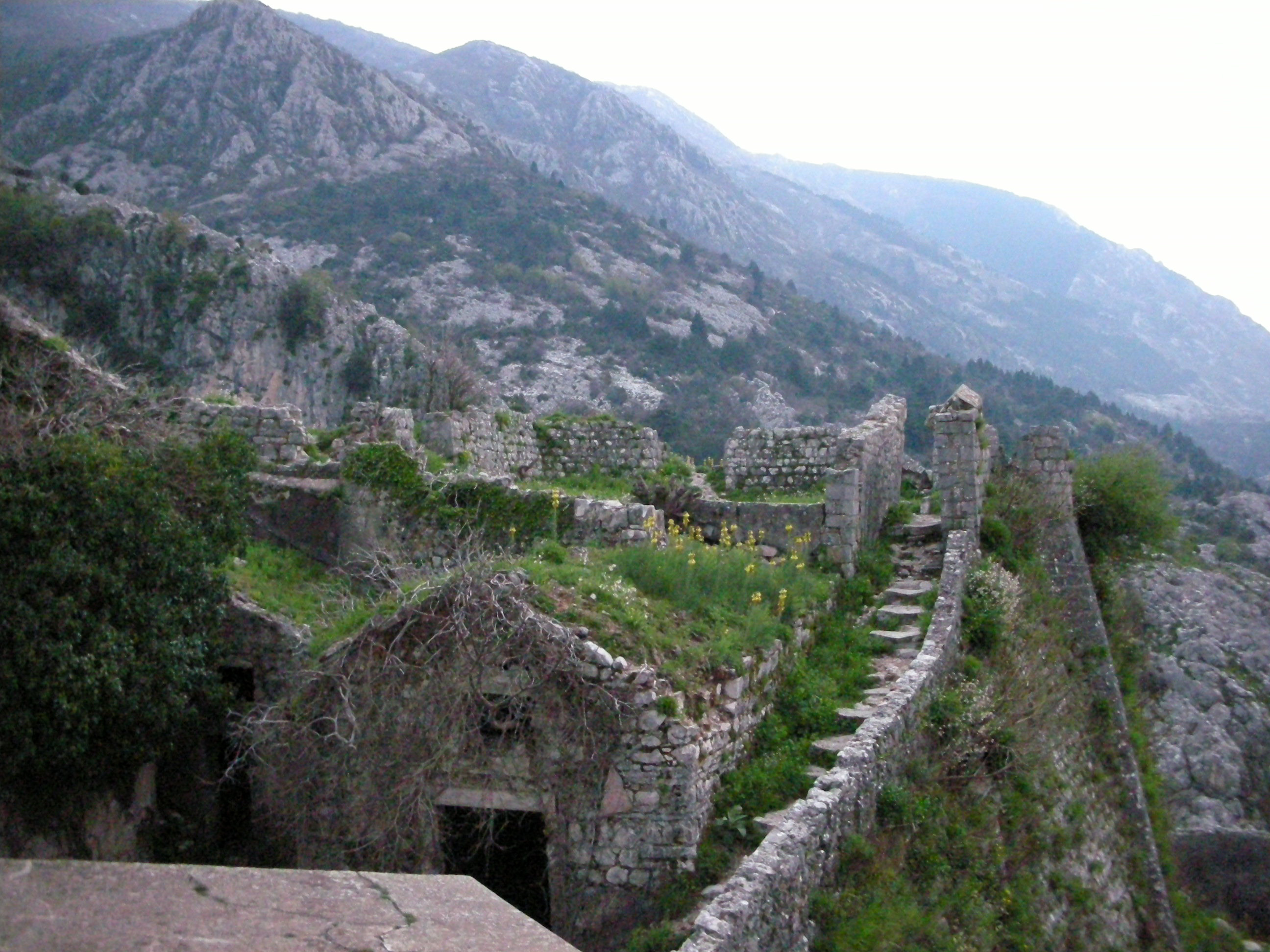 stairs and mountainside stone buildings in kotor montenegro image