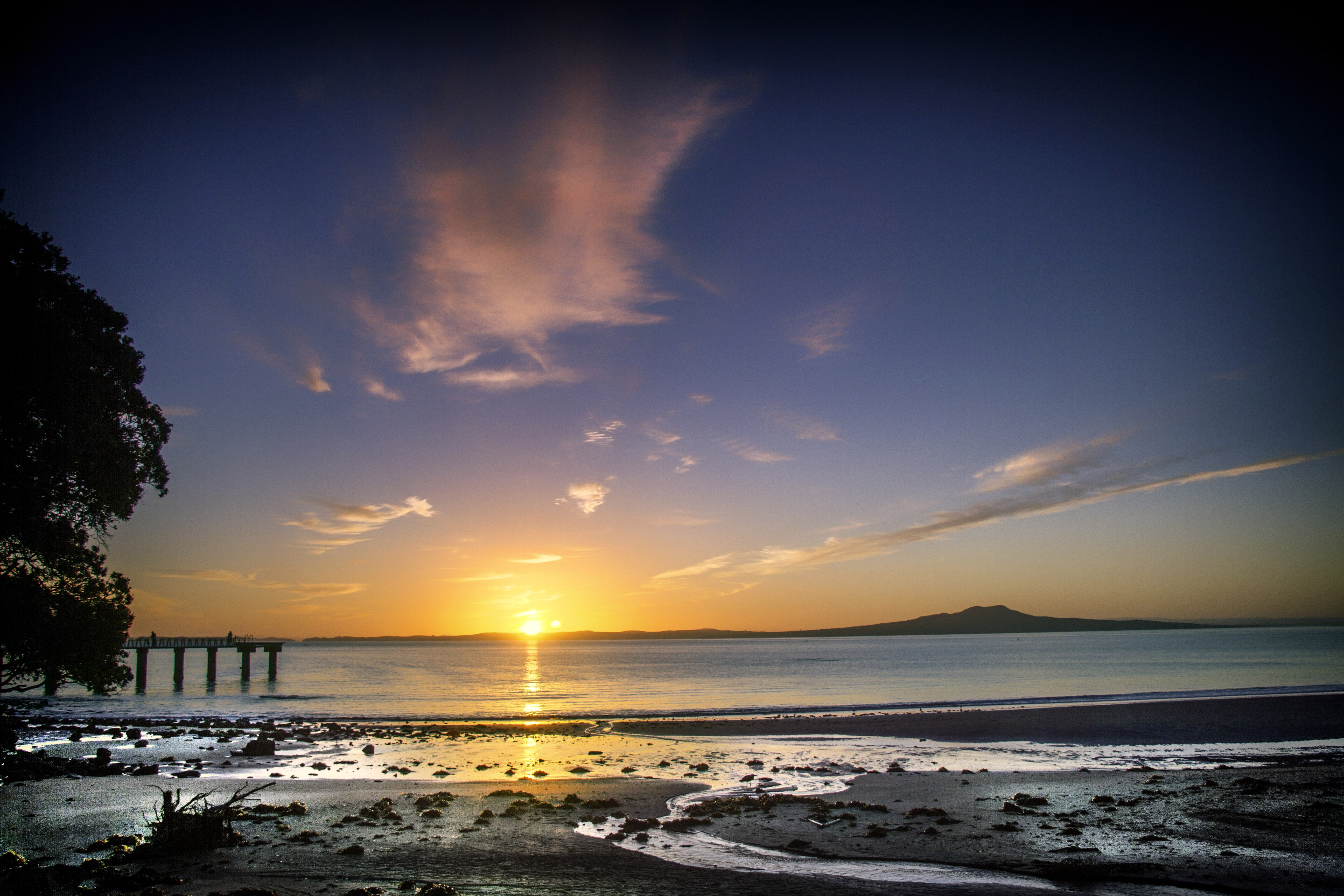 sunrise on the beach in auckland  new zealand image - free stock photo