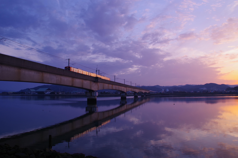 Train Crossing the Bridge over glassy water image - Free