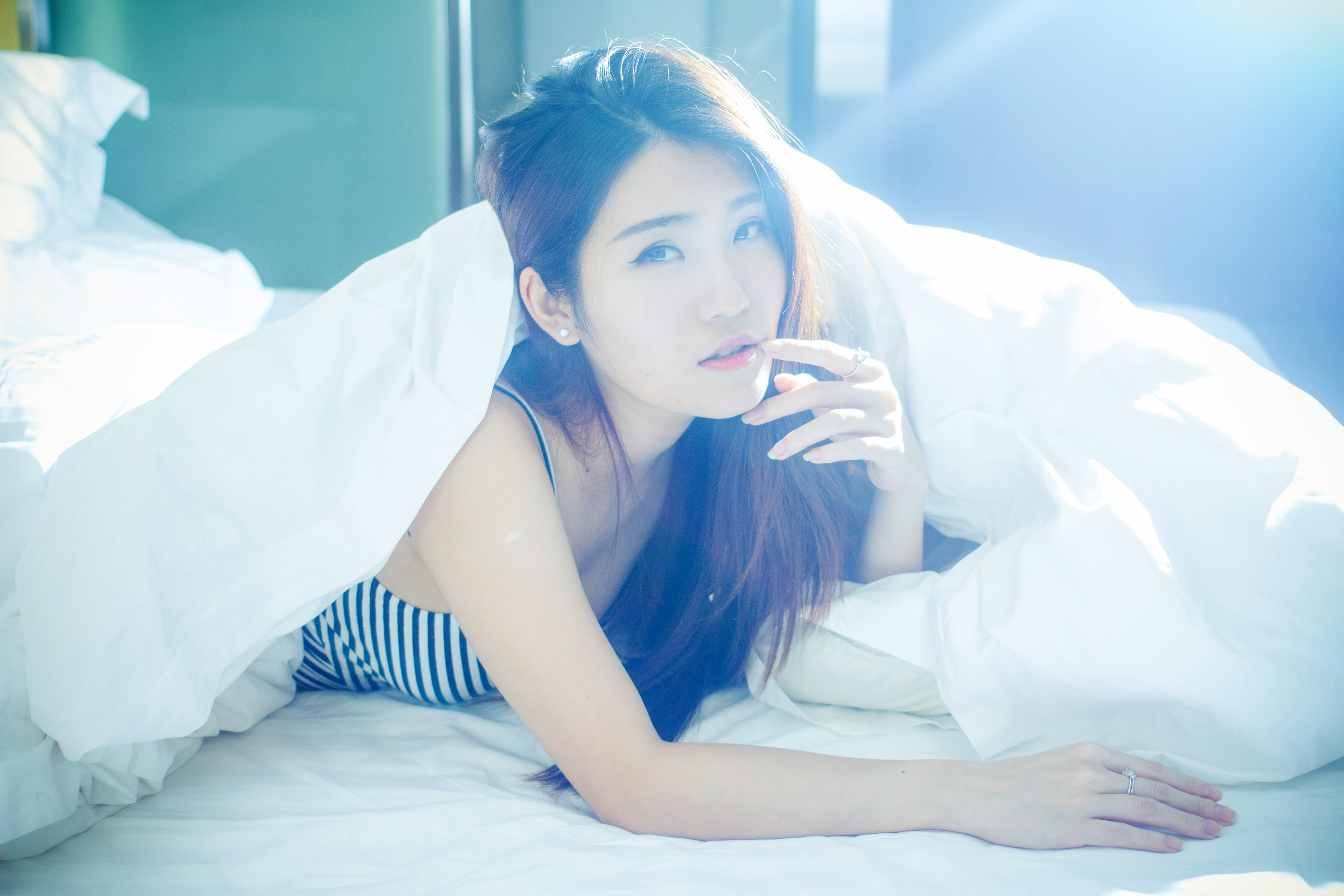 beautiful-asian-girl-in-bed-in-sunlight image - Free stock