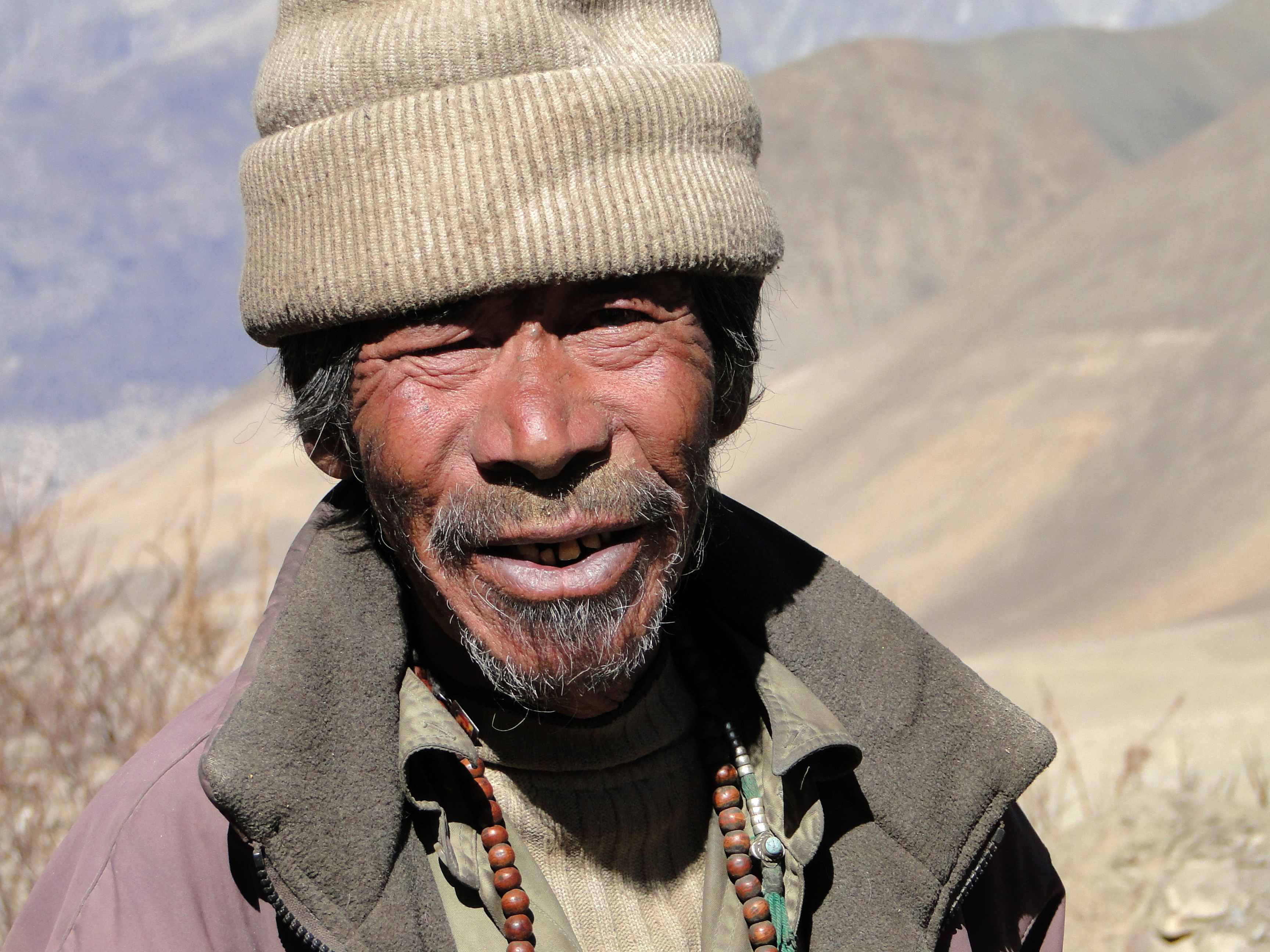 Old Man In Nepal With A Weather Beaten Face Image Free