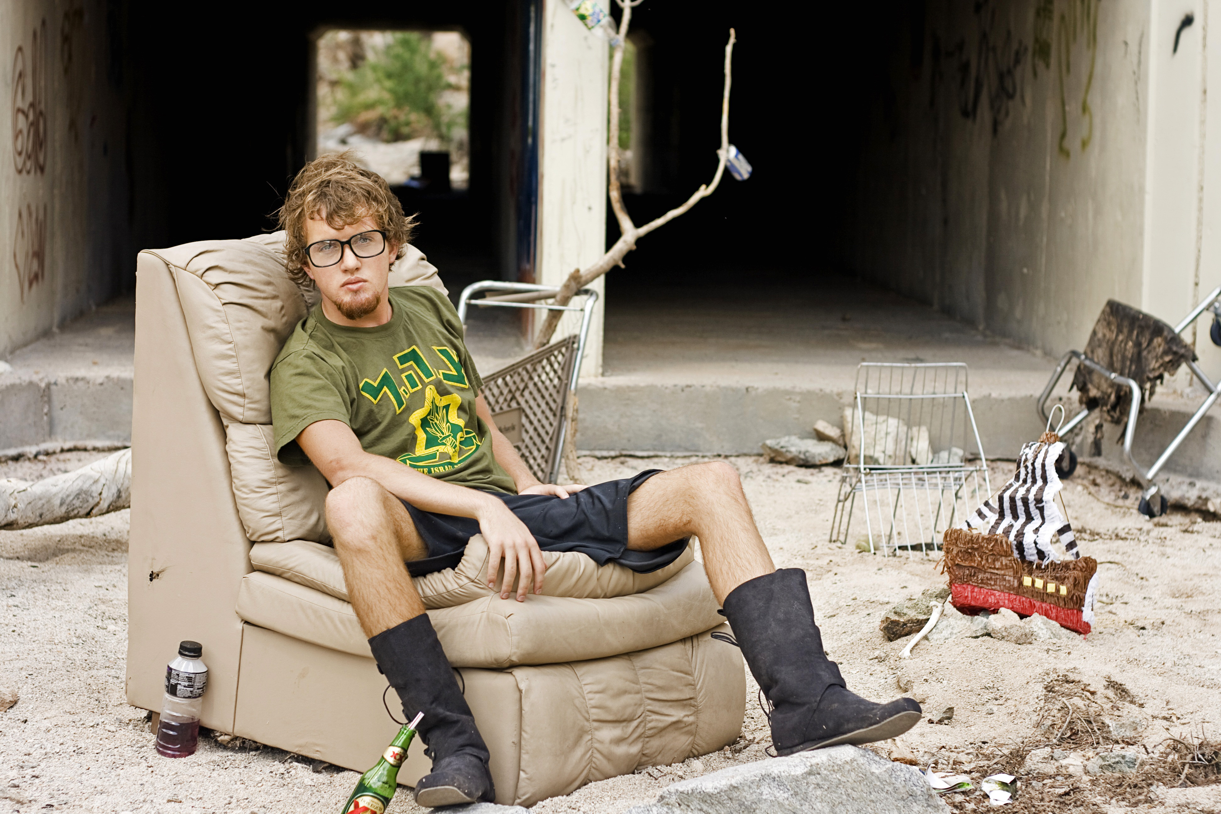 poor-man-sitting-on-couch-on-abandoned-house image - Free
