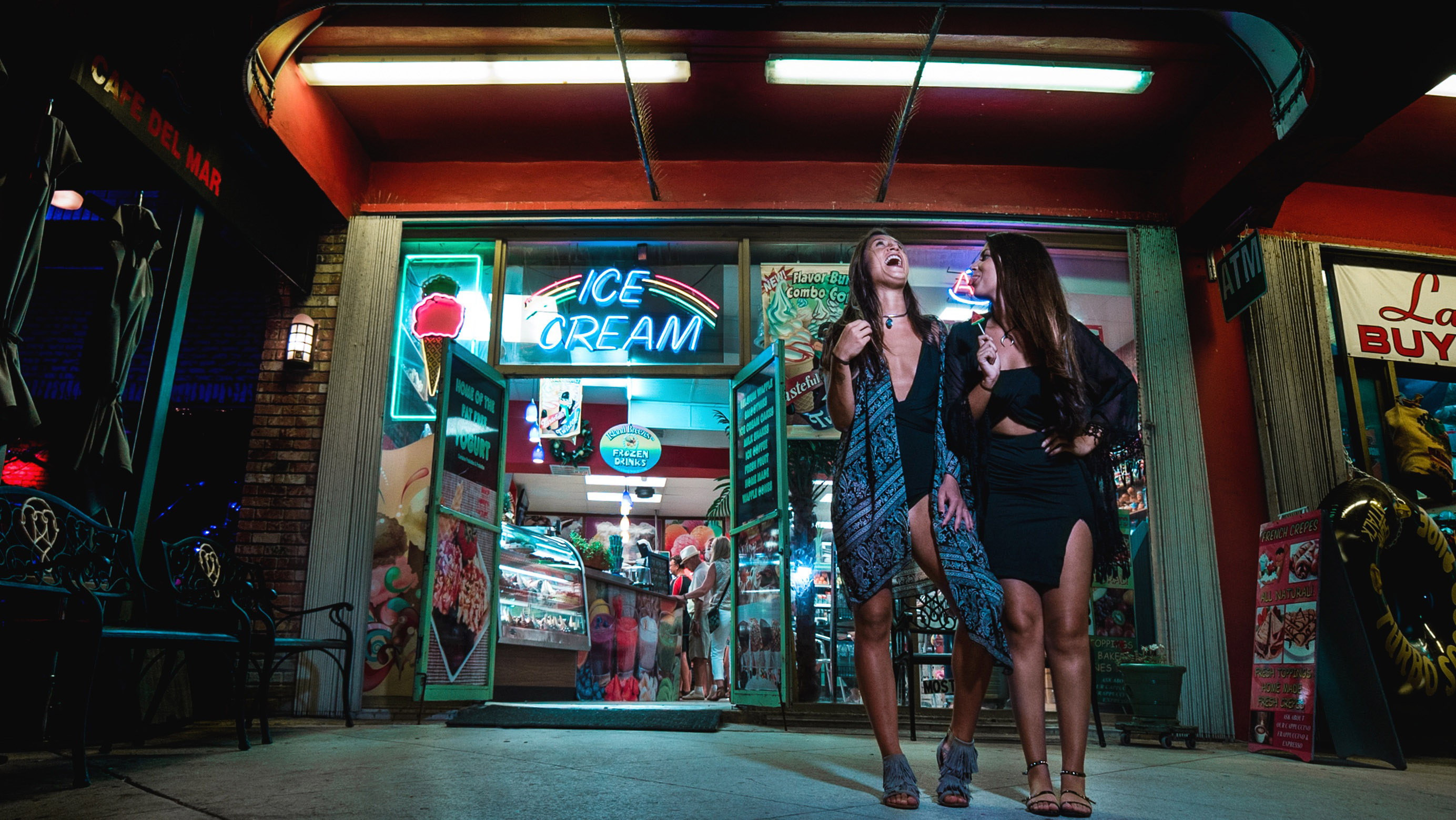 Two Girls Standing Outside Ice Cream Shop Image