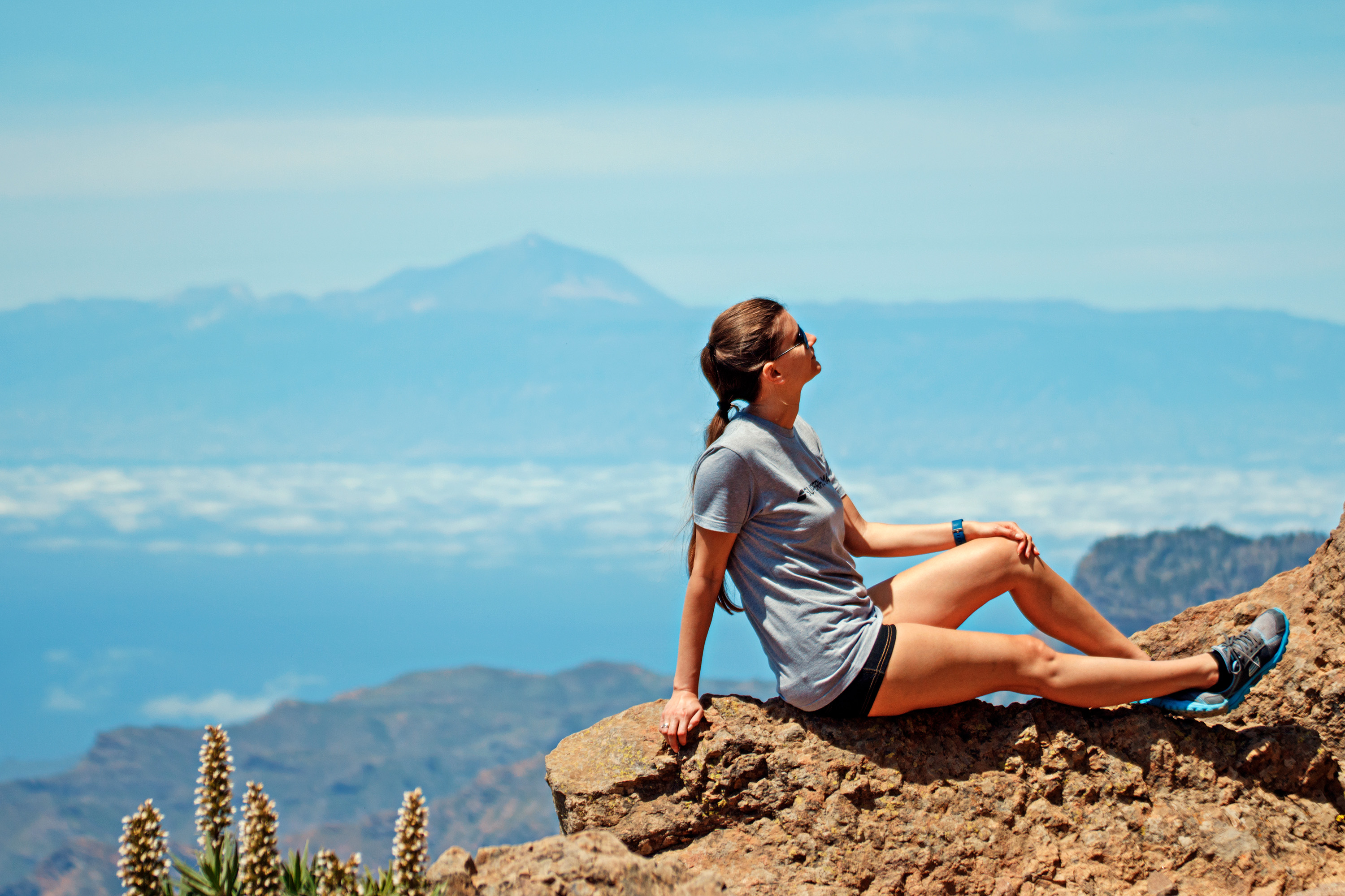 Woman Sitting On Top Of A Mountain Photo By Adam Kontor