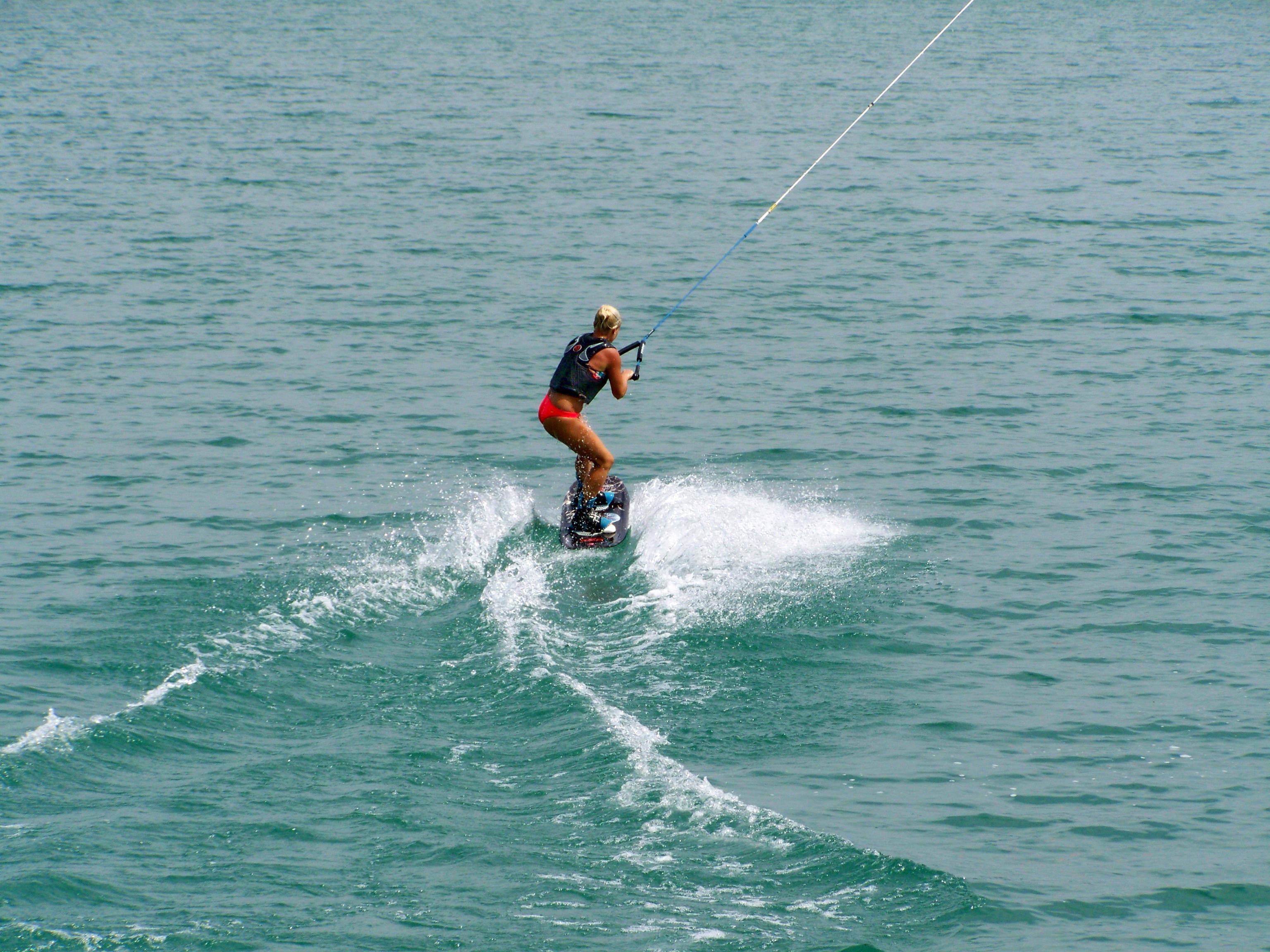 Woman Waterboarding On Lake Image Free Stock Photo