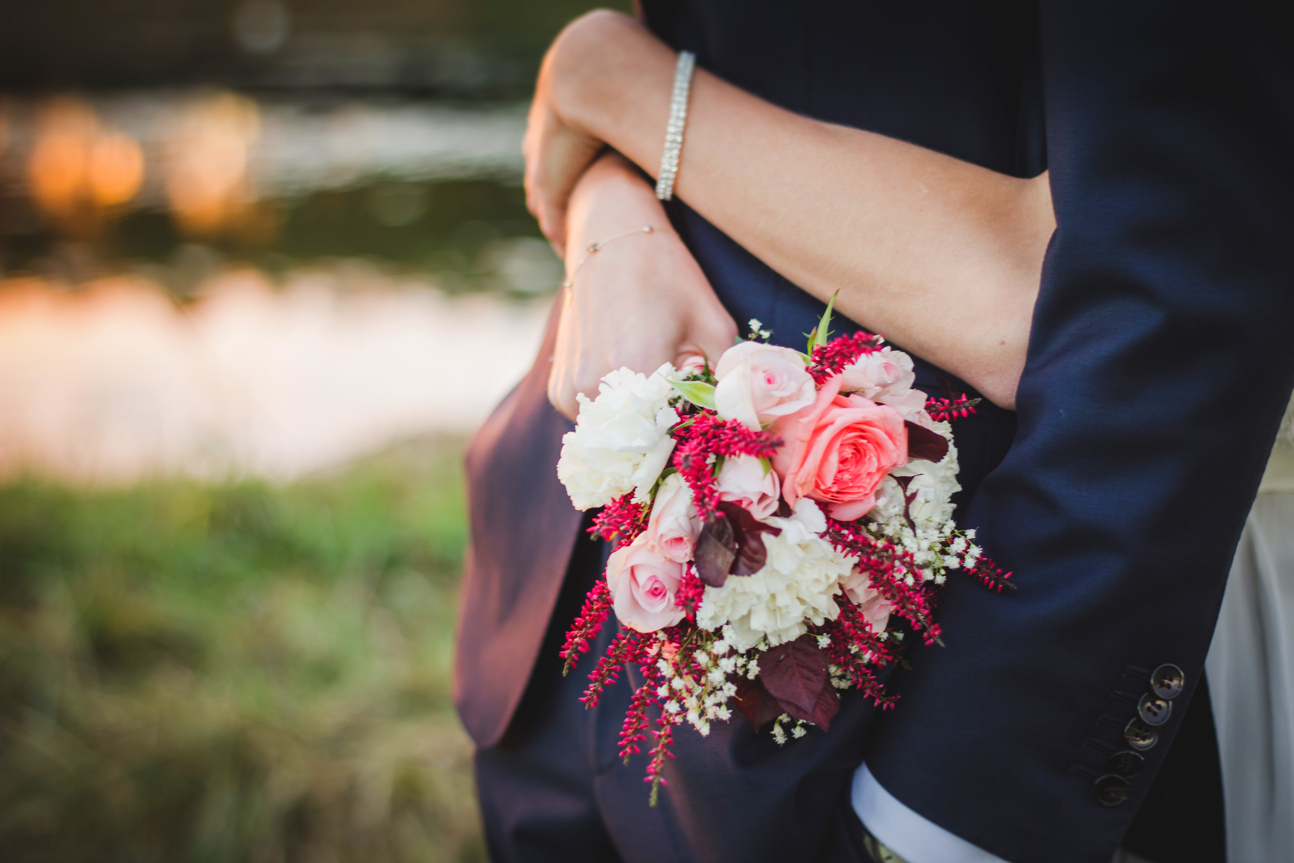 Woman with arms wrapped around a man with bouquet flowers image free izmirmasajfo