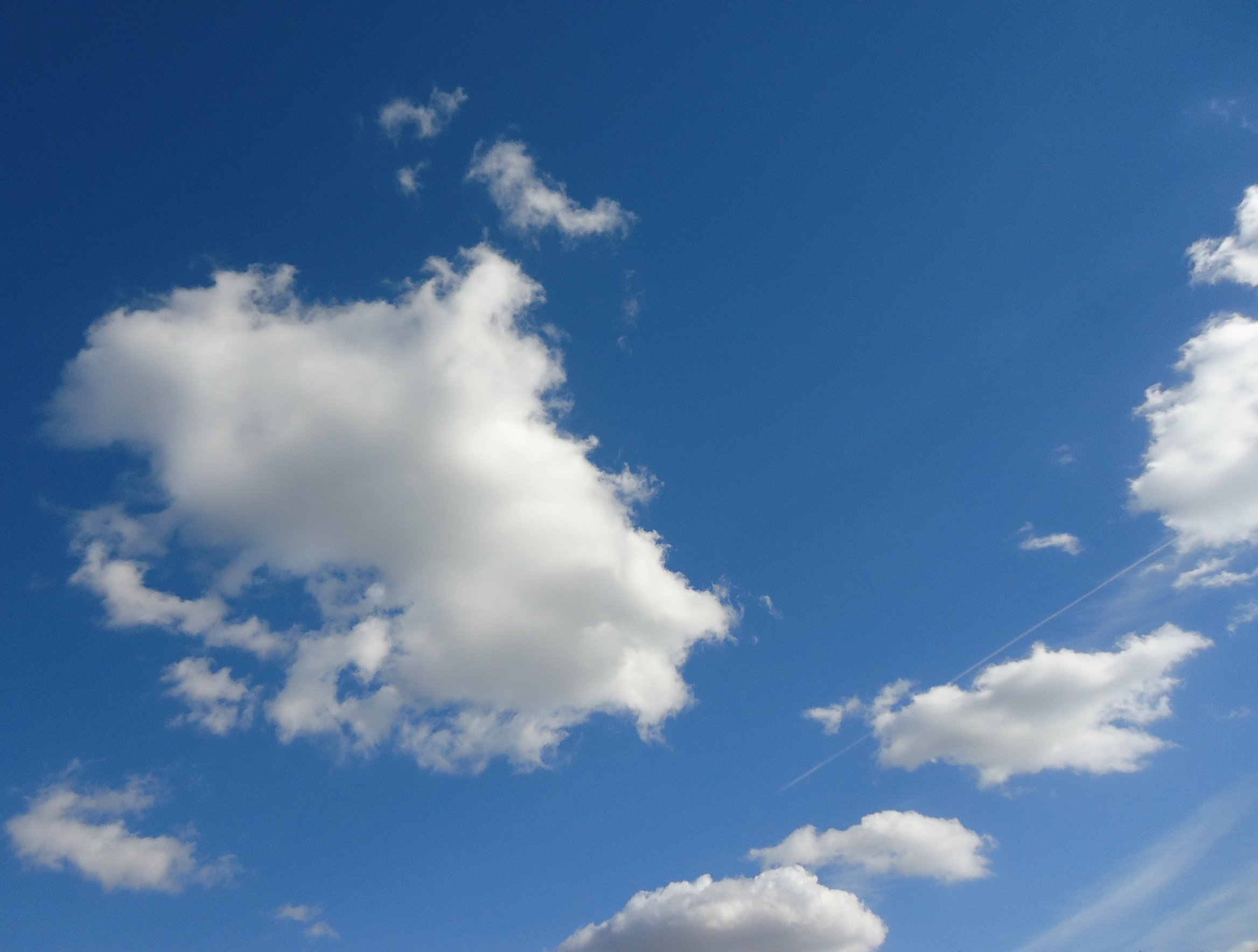 Clouds On A Mostly Clear Sky Image
