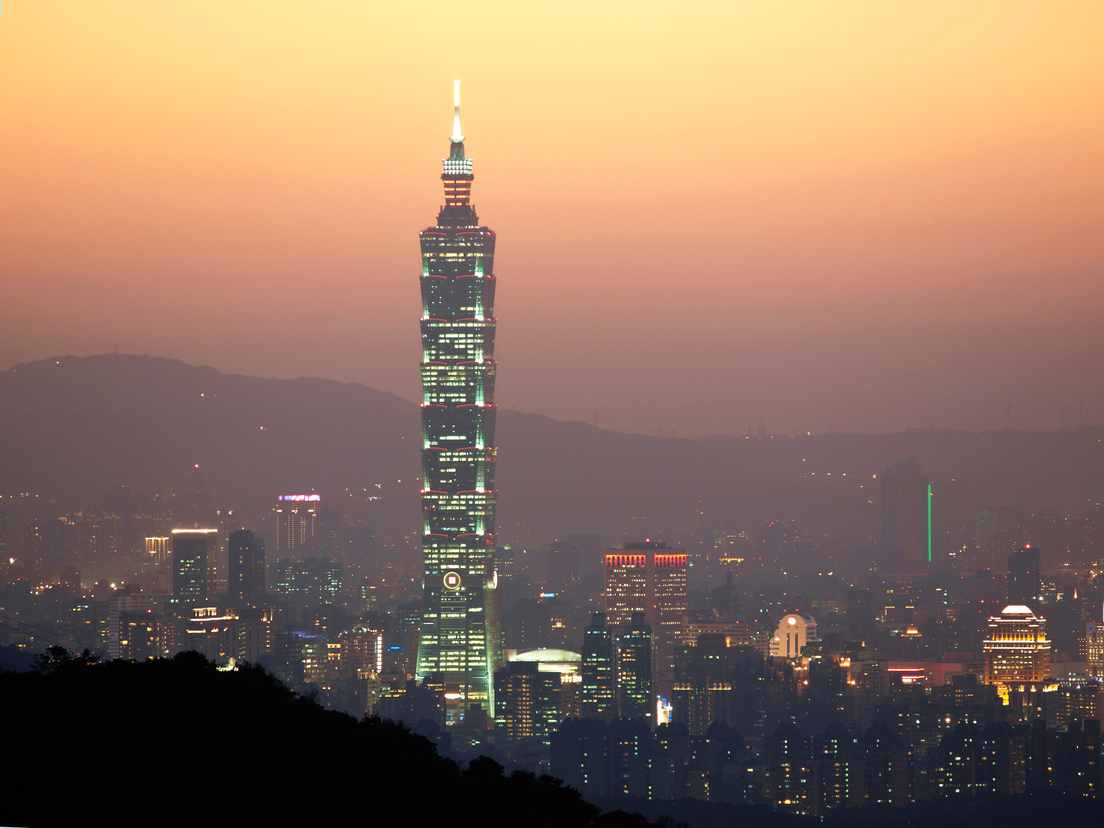 Taipei 101 with lights at dusk in Taiwan image - Free