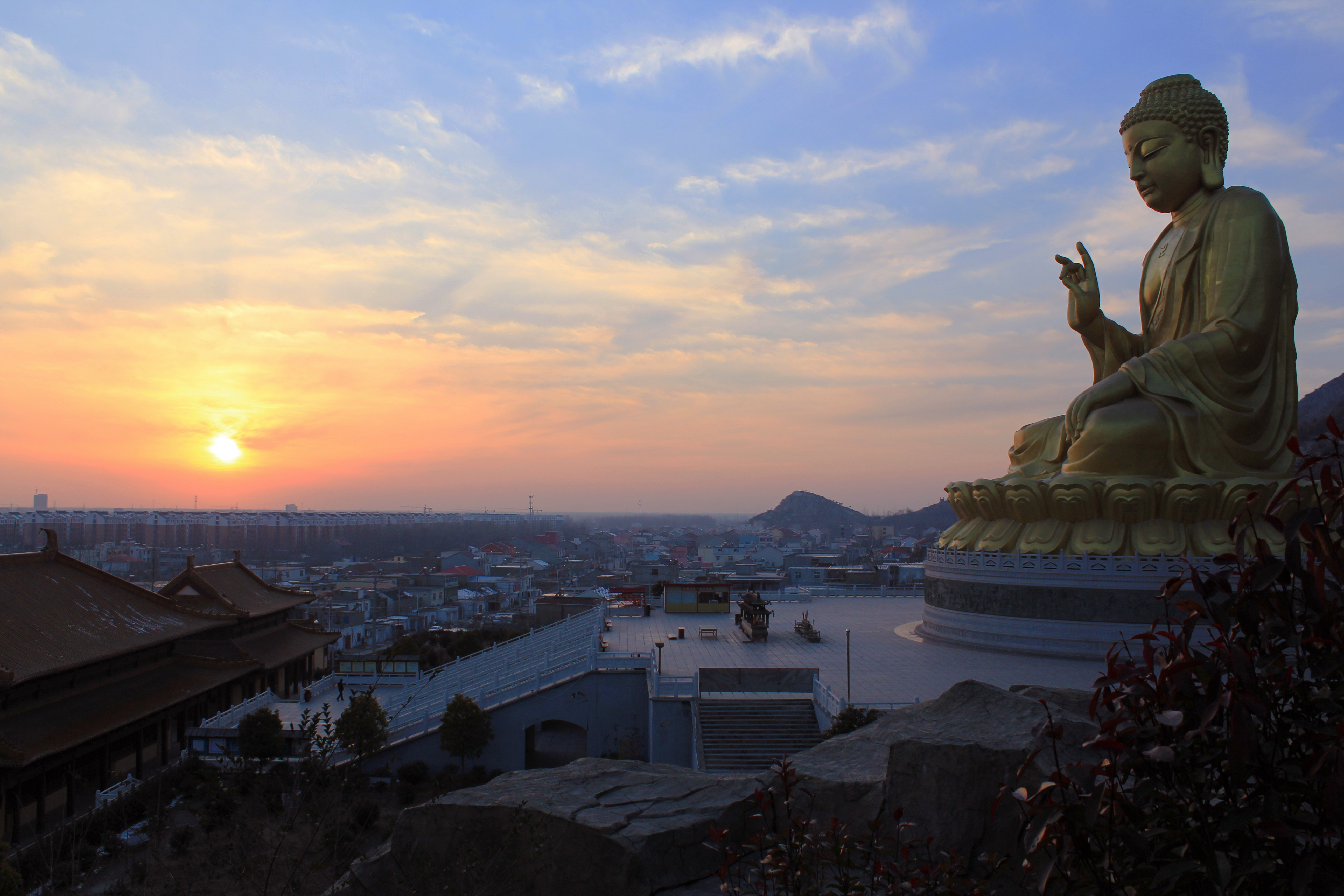 buddha watching over the city at sunset in thailand image