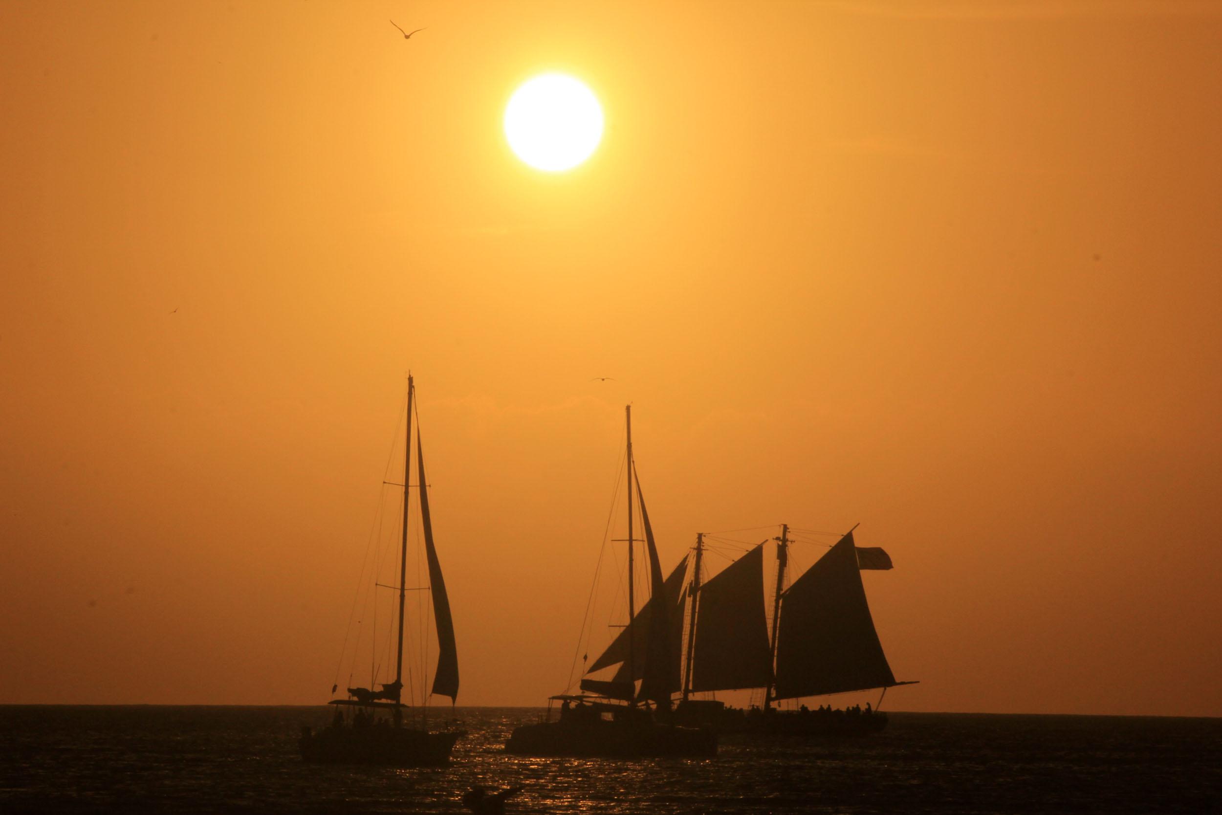 Boats under setting sun