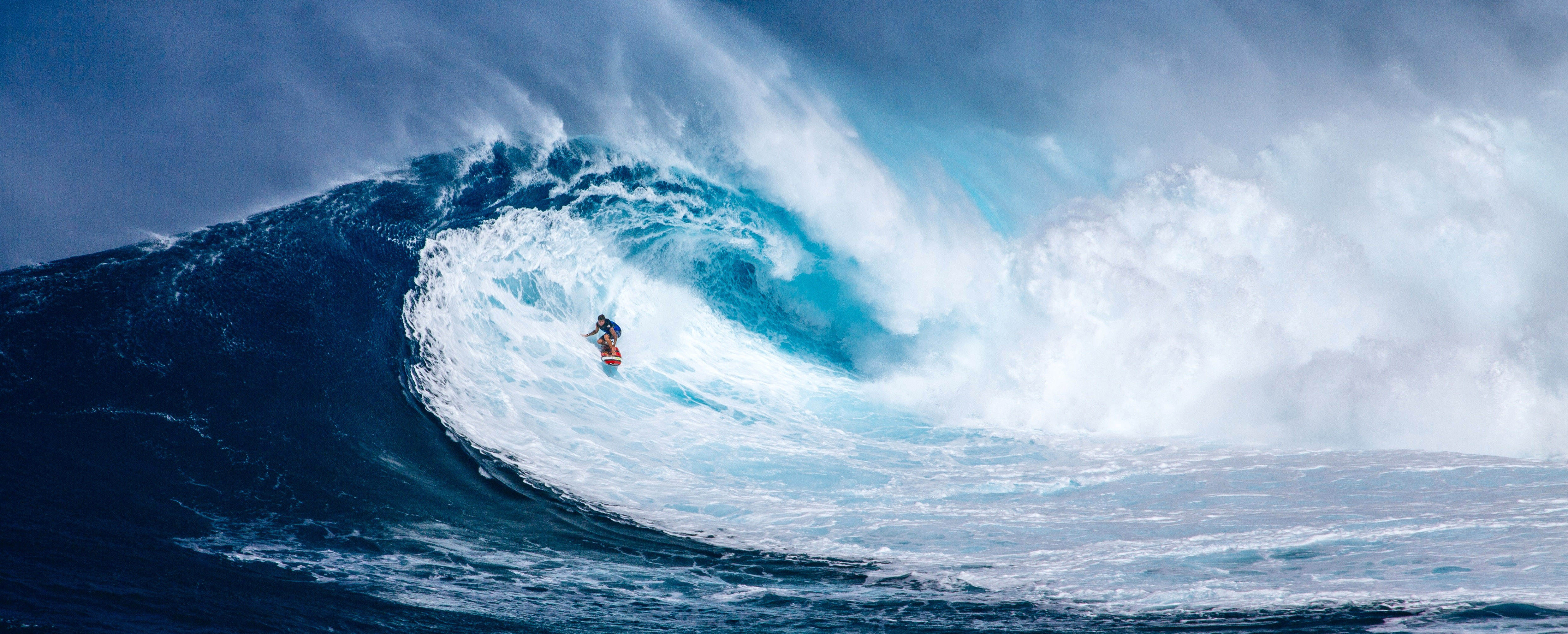 Surfer Riding Giant Wave In Hawaii Image Free Stock Photo