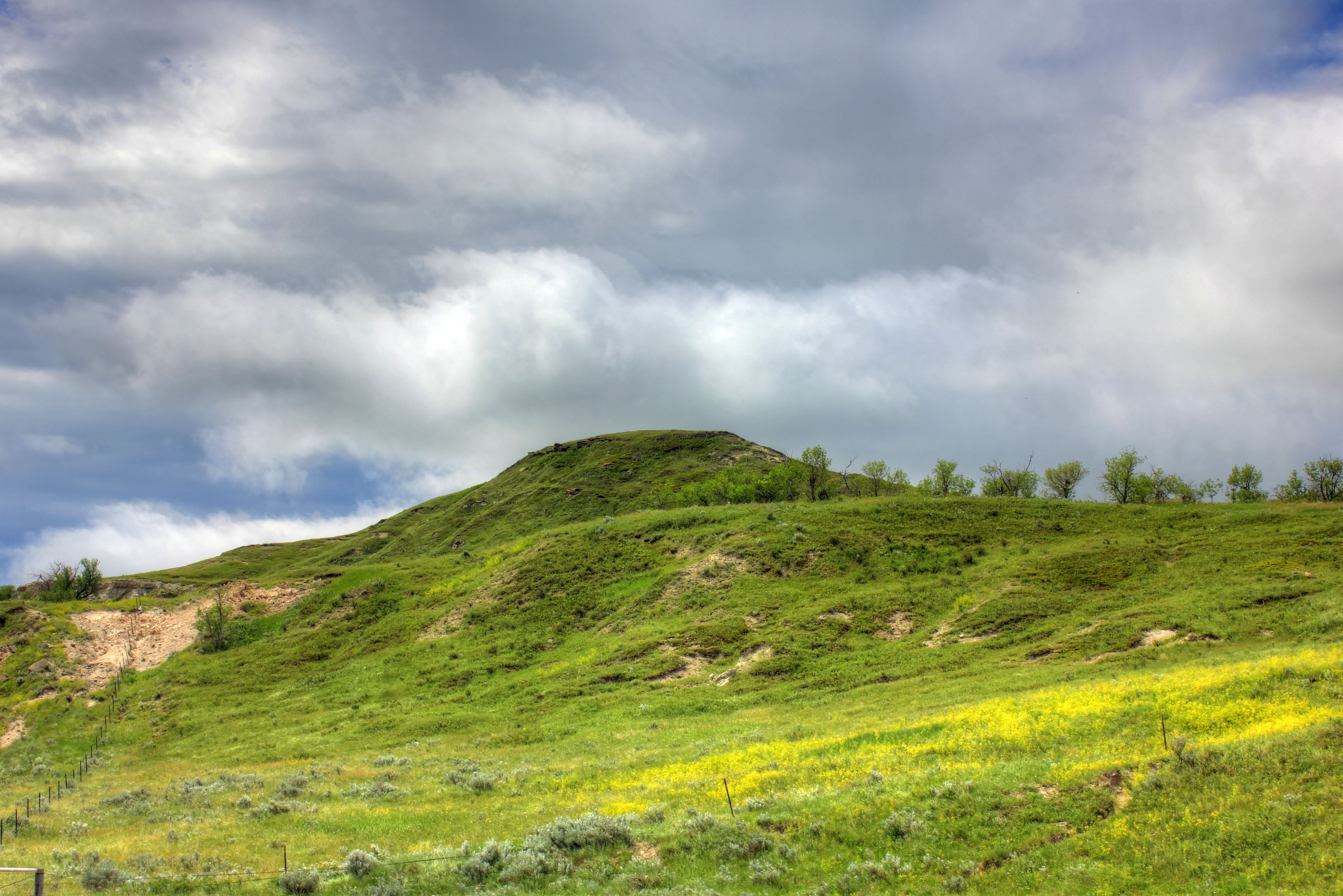 Heavy clouds over the hilltop at White Butte, North Dakota - Free ...