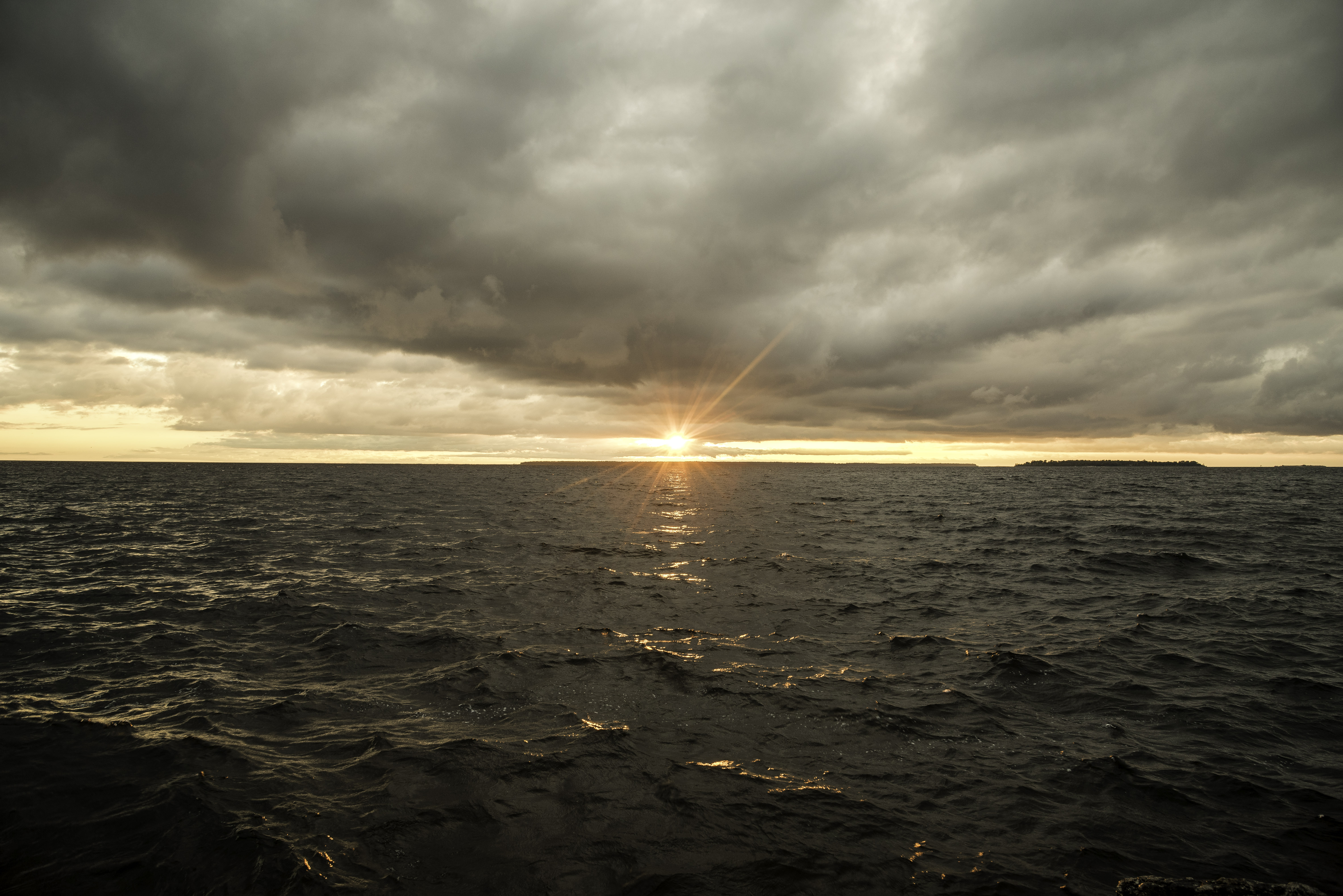 sunset under the clouds over lake michigan at peninsula