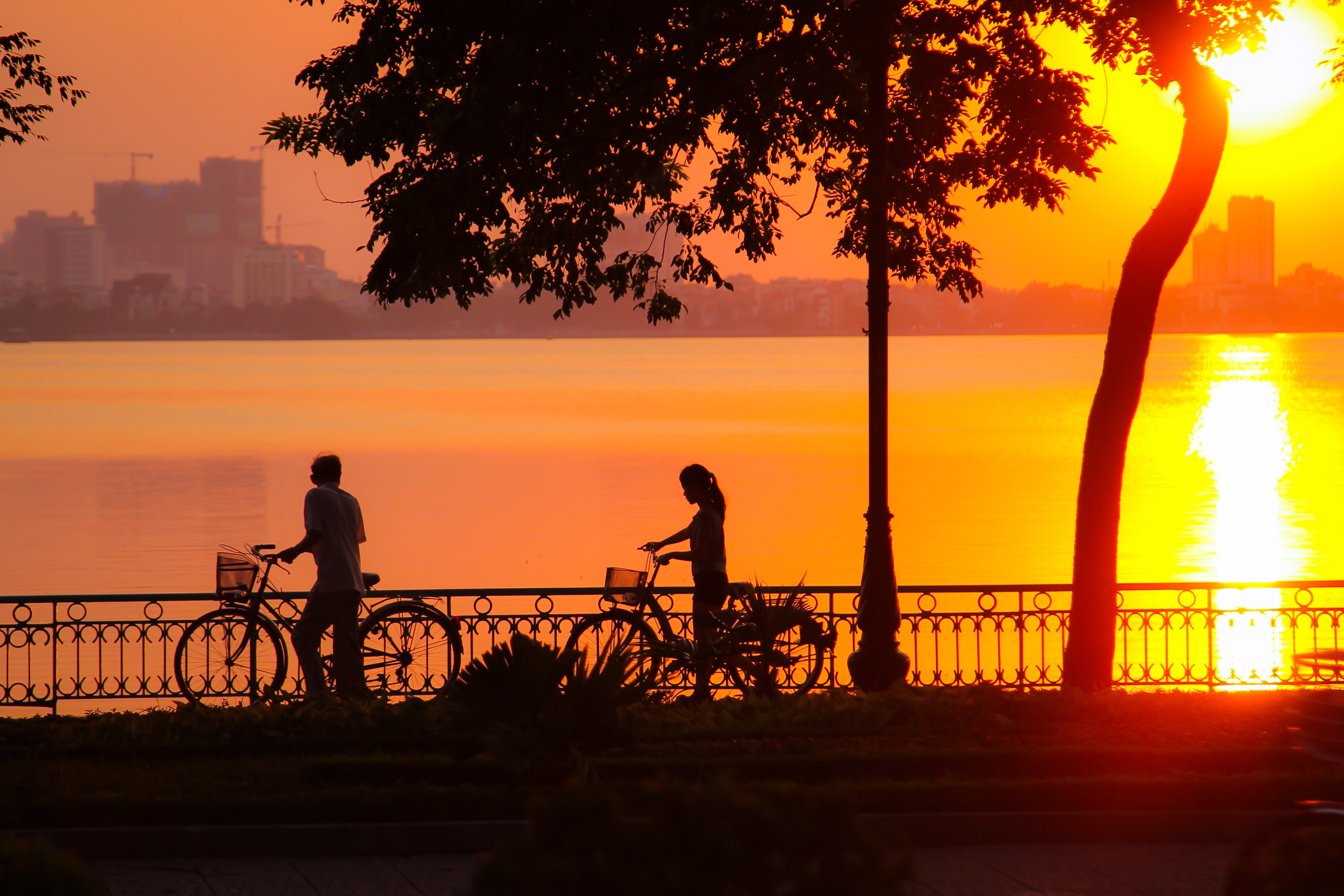 Sunset and 2 cyclists in Hanoi, Vietnam image - Free stock ...