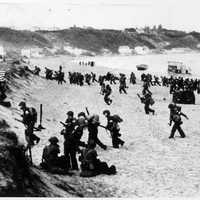 Troops landing on beach near Algiers