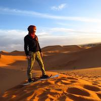 Man Standing on a sand dune in Algeria