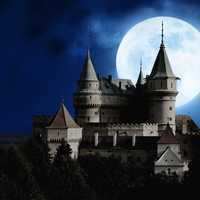 Moon behind th castle