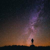 Person standing under the Milky Way