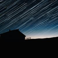 Star Trails and house silhouette at night astrophotography