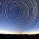 Star Trails in the Sky above the landscape