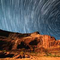 Star trails over the rocky landscape