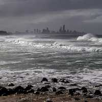 Rough Ocean surf and city skyline in Queensland, Australia