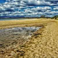 Beach with clouds in the sky in Tasmania, Australia