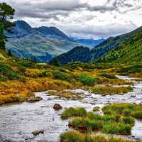 Mountain Valley Landscape with Stream running through