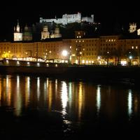 The fortress, Cathedral, and river at night in Salzburg, Austria
