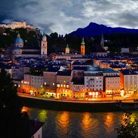 Riverfront lights and cityscape in Salzburg, Austria