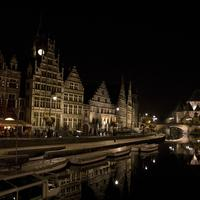 River and cityscape at night in Ghent, Belgium