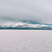Person running on the salt flats beautiful landscape