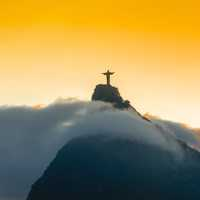 Sunset and dusk over the Christ Statue in Rio De Janeiro, Brazil