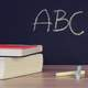 Books and Chalkboard with ABC
