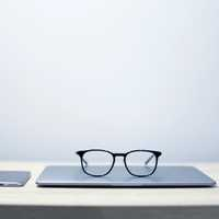 Glasses sitting on laptop