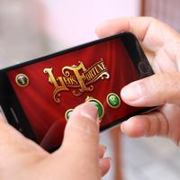 Person playing app on mobile phone