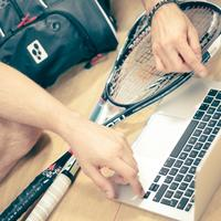 Raquetball player working on macbook pro