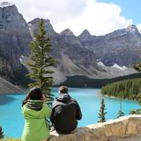 Couple looking at a Aquamarine Lake landscape in Banff National Park, Alberta, Canada