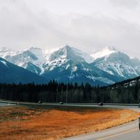 Driving on the road into the mountains in Banff National Park, Alberta, Canada