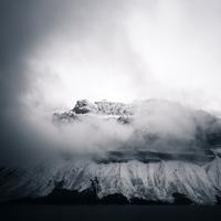 Fog over the mountaintop with snow in Banff National Park, Alberta, Canada