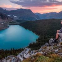 Man Sitting and overlooking the beautiful lake landscape at Banff National Park, Alberta, Canada