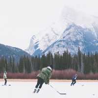 People playing Hockey on frozen lake in Banff National Park, Alberta, Canada